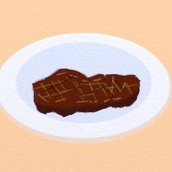 白いお皿につけ合わせなしステーキ