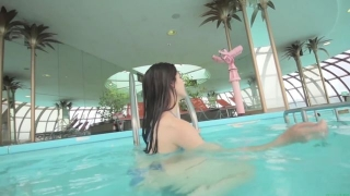 Maimi Yajima relaxing in the pool light blue bikini swimsuit picture067